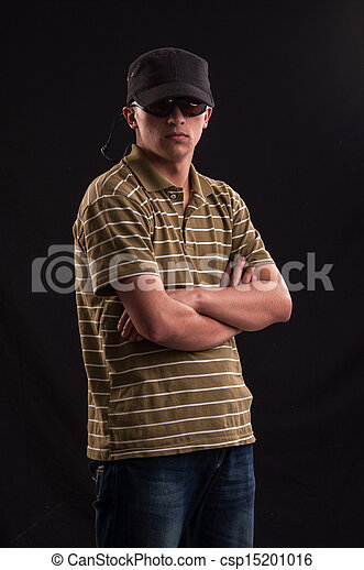 Serious young caucasian man with sunglasses and baseball hat