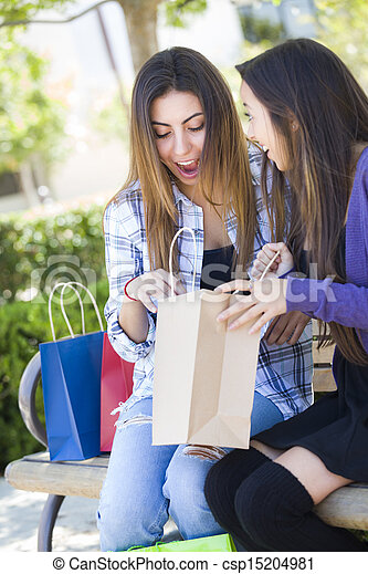 Young Adult Mixed Race Women Looking Into Their Shopping Bags - csp15204981