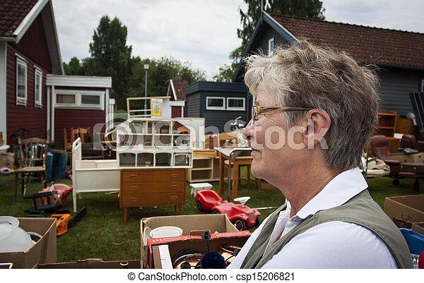 Senior woman at auction - csp15206821