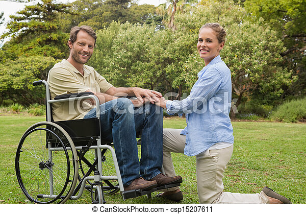 Stock photography of handsome man in wheelchair with House plans for disabled people