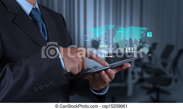 businessman hand using tablet computer and board room  - csp15209661