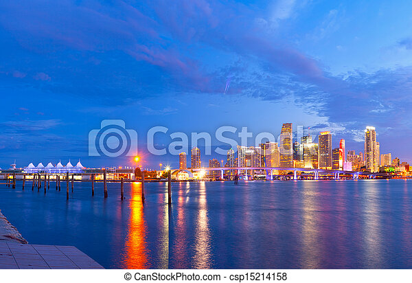 CIty of Miami Florida, summer sunset panorama with colorful illuminated business and residential buildings and bridge on Biscayne Bay - csp15214158