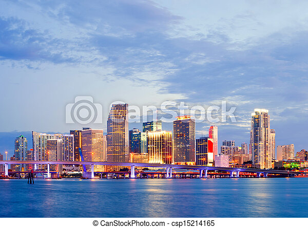 CIty of Miami Florida, summer sunset panorama with colorful illuminated business and residential buildings and bridge on Biscayne Bay - csp15214165