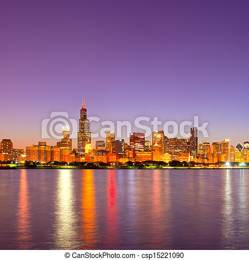 City of Chicago USA, sunset colorful panorama skyline of downtown with illuminated business buildings with reflections - csp15221090