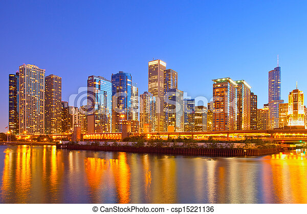 City of Chicago USA, colorful sunset panorama skyline of downtown with illuminated business buildings with reflections - csp15221136