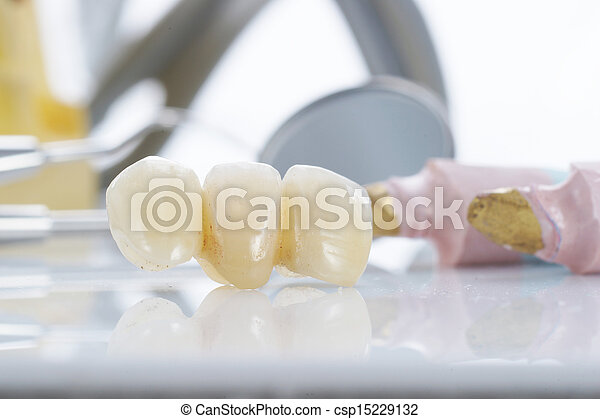 Macro of prosthetic teeth with dental tools - csp15229132