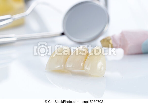 Macro of prosthetic teeth with dental tools - csp15230702
