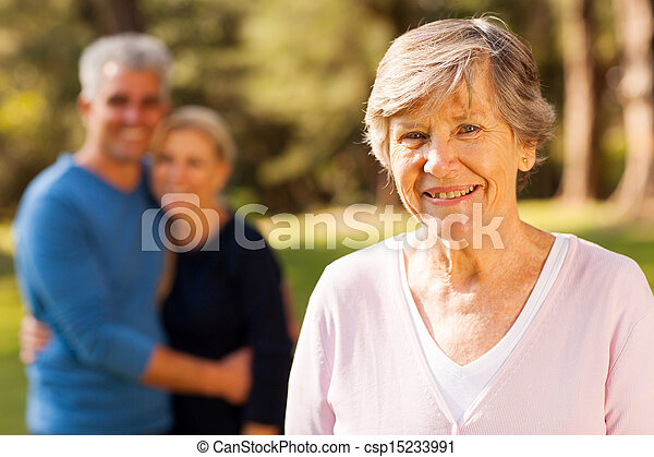 senior woman  in front of middle aged son and daughter-in-law - csp15233991