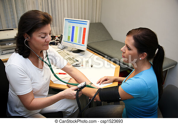 Medical doctor at the blood pressure - csp1523693