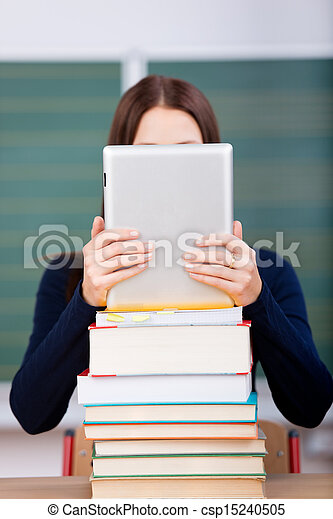 Woman with books and ipad touch - csp15240505