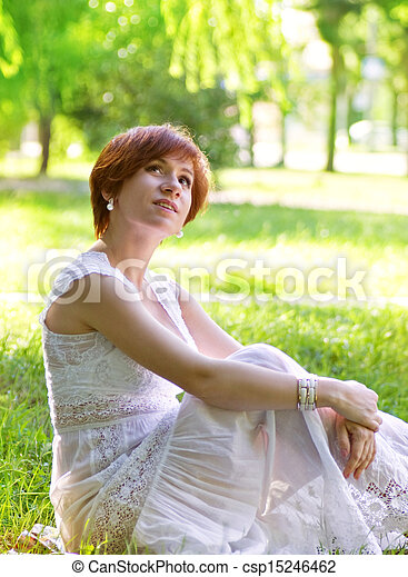Stock image of pregnant woman in green garden beautiful for Gardening while pregnant
