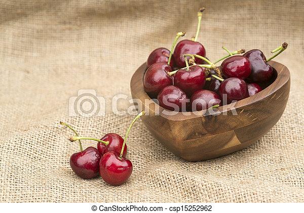 Fresh Summer cherries in wooden bowl - csp15252962