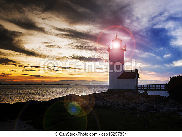 Annisquam lighthouse at sunset - csp15257854