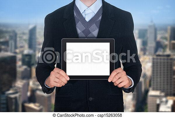 Businessman showing blank digital tablet - csp15263058
