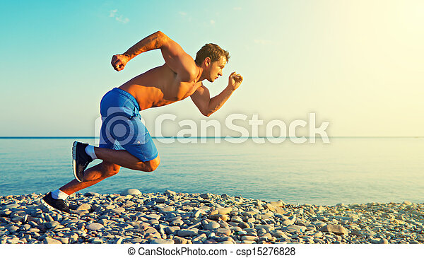 man athlete running by the sea at sunset outdoors - csp15276828