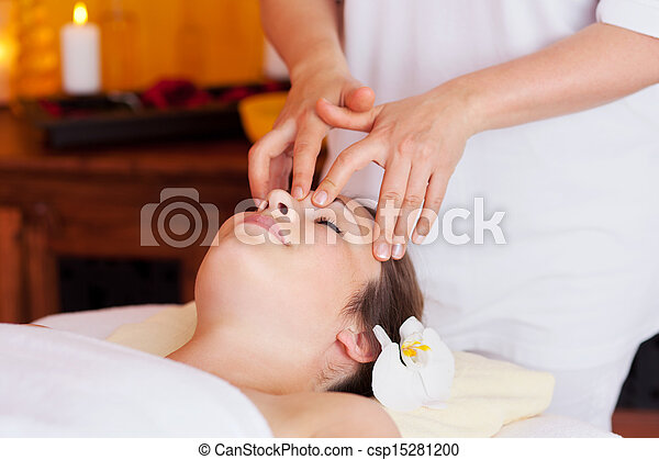 Woman having a facial massage in a spa