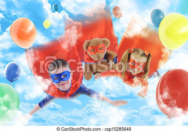 Little Superhero Kids Flying in the Sky - csp15285649