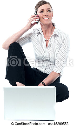 Woman woking on laptop and communicating - csp15299553