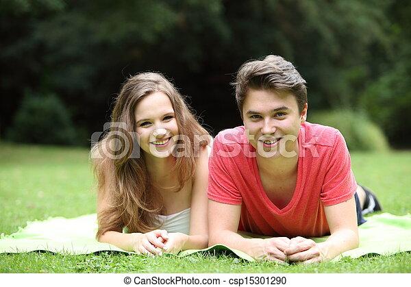Stock fotografieken van aantrekkelijk tiener jongen meisje het liggen samen csp15301290 - Tapijt tienerjongen ...