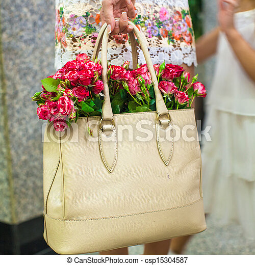 Small red charming flowers in fashion women's bag - csp15304587