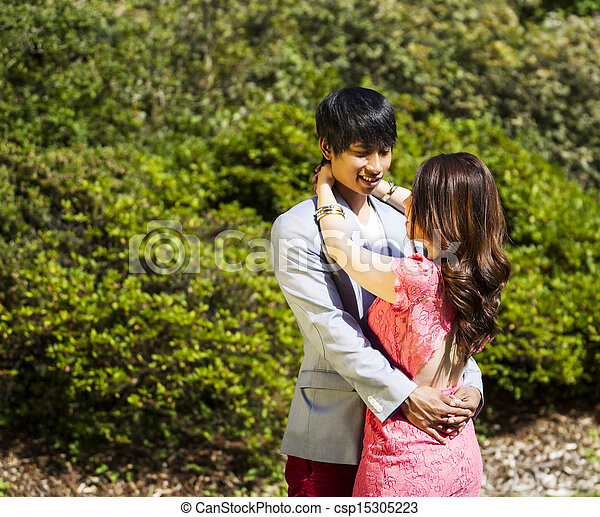 Young Adult Couple Embracing Outdoors  - csp15305223