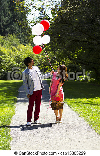 Young Adult Couple having Fun while going for a walk  - csp15305229