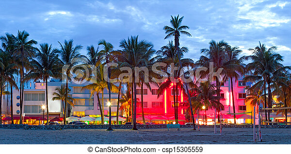 Miami Beach, Florida  hotels and restaurants at sunset on Ocean Drive, world famous destination for it's nightlife, beautiful weather, Art Deco architecture and pristine beaches - csp15305559