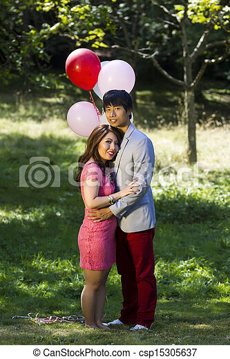 Young Adult Couple Sharing a Romantic moment outdoors  - csp15305637