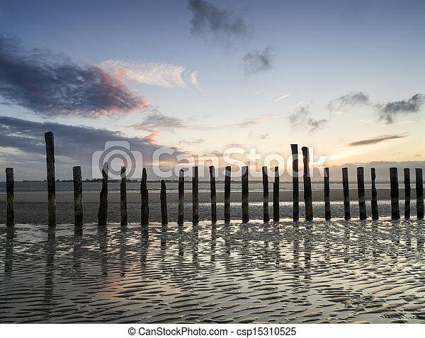 Beautiful landscape Summer sunset sky reflected on wet beach at  - csp15310525