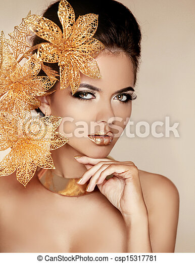 Beautiful Girl With Golden Flowers. Beauty Model Woman Face. Perfect Skin. Professional Make-up. Makeup. Fashion Art Photo. - csp15317781