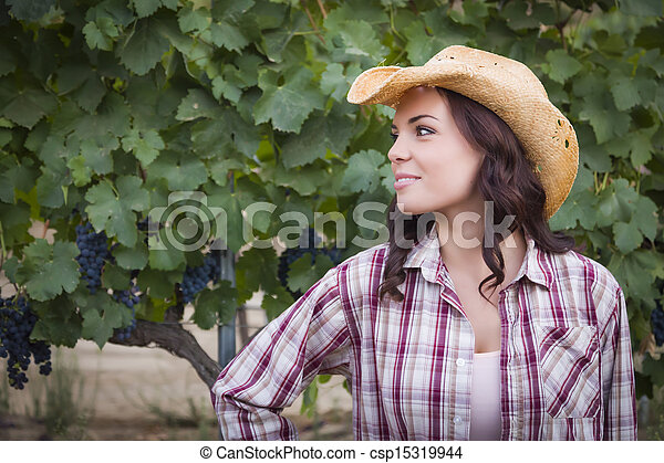 Young Adult Female Portrait Wearing Cowboy Hat in Vineyard - csp15319944