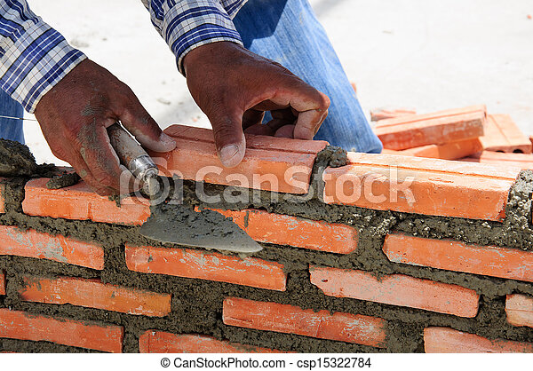 Pictures of construction mason worker bricklayer installing brick ...