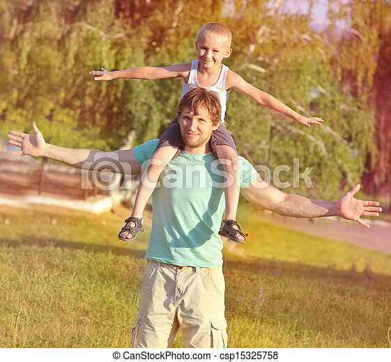 Family Father Man and Son Boy sitting on shoulders playing Outdoor park Happiness emotion with summer nature on background - csp15325758