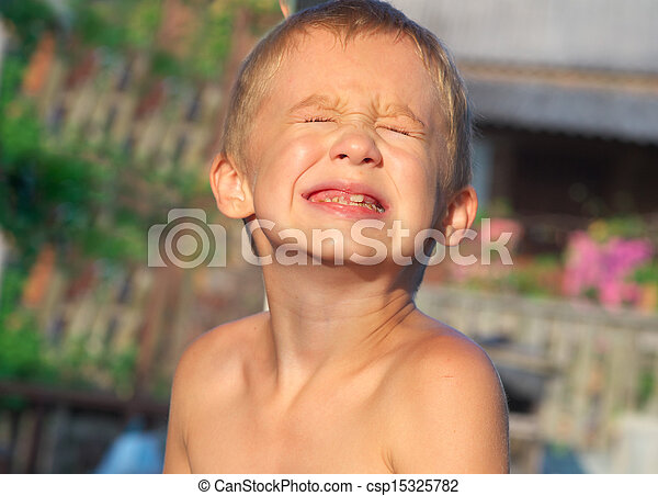Little boy making sore crying Faces showing Calf's Teeth Decay Dental problems concept pain emotions - csp15325782