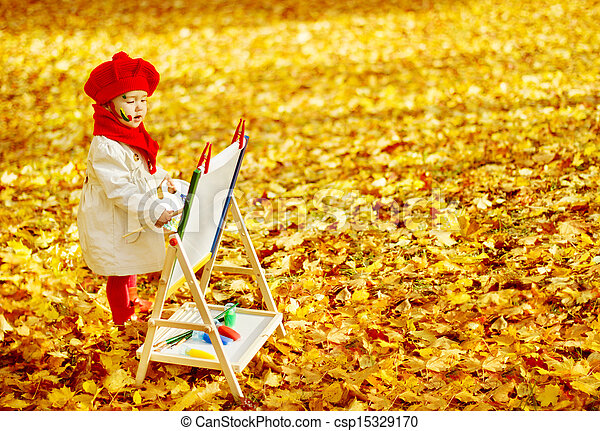 Child drawing on easel in Autumn Park. Creative kids development concept. - csp15329170