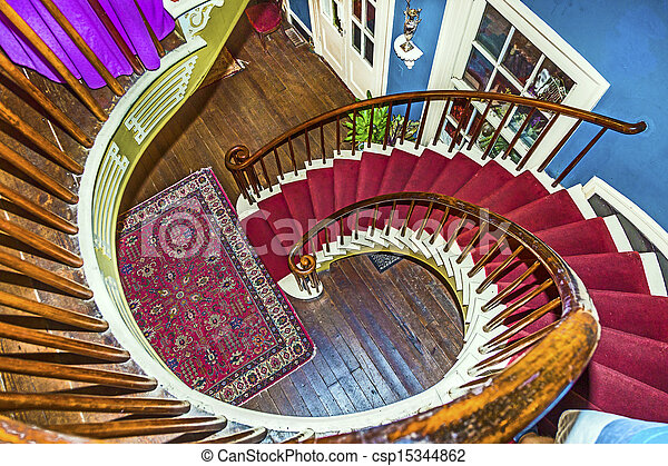 Spiral stairs to upper bedrooms and parlors in the old plantation house