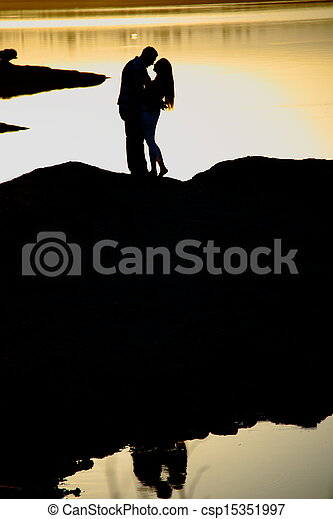 romantic couple at sunset - csp15351997