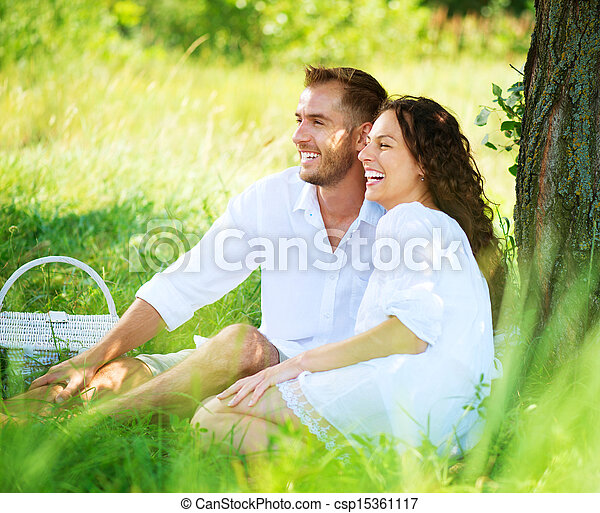 Young Couple Having Picnic in a Park. Happy Family Outdoor  - csp15361117