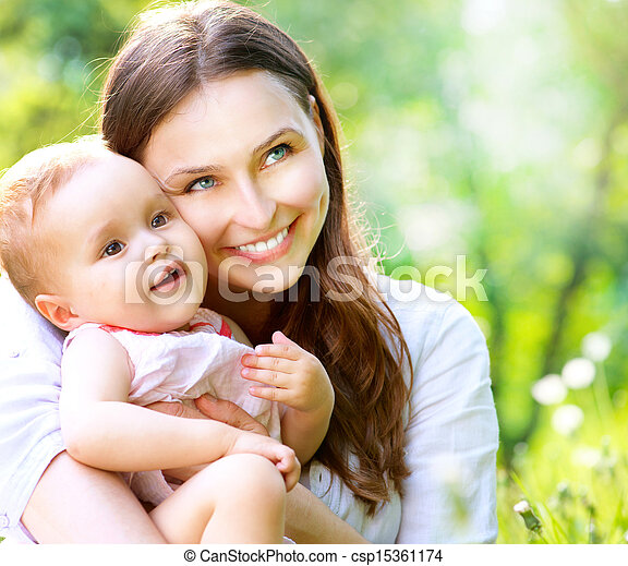 Beautiful Mother And Baby outdoors. Nature  - csp15361174