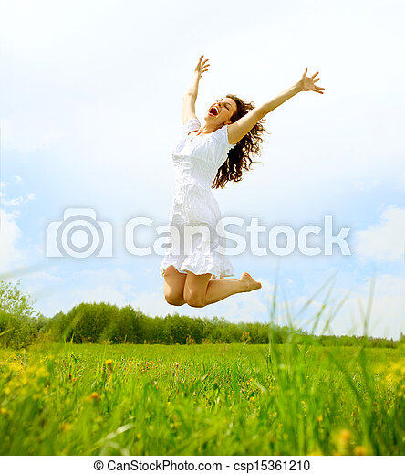 Happy Young Woman Jumping over blue sky. Beauty Girl Having Fun  - csp15361210