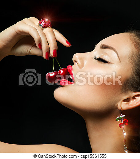 Sexy Woman Eating Cherry. Sensual red Lips with Cherries - csp15361555