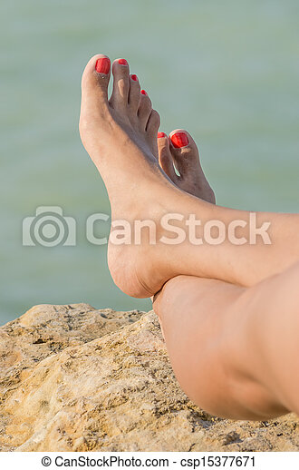 Young Girl Bare Feet On The Beach - csp15377671