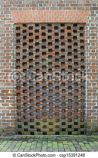 An unusual old moss covered bricked up old doorway in the side of a brick wall & Stock Photo of An unusual old moss covered bricked up old doorway ... Pezcame.Com