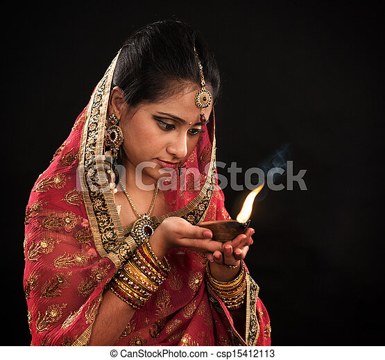 Diwali Indian woman with oil lamp - csp15412113