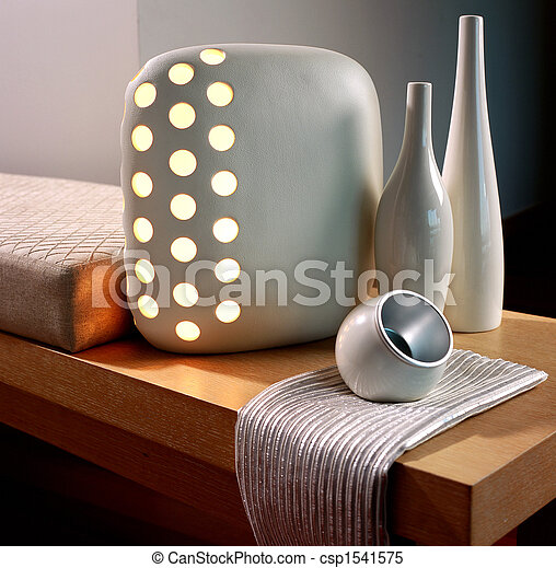 Stylish lamp on a table - csp1541575