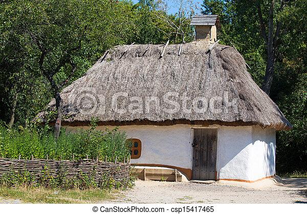 Wooden houses taken in park in summer in Pirogovo museum, Kiev, Ukraine - csp15417465