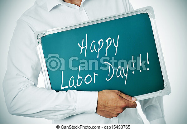 a man holding a chalkboard with the sentence happy labor day written in it