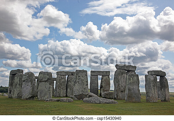 Stonehenge historic site on green grass under blue sky. Stonehenge is a UNESCO world heritage site in England with origins estimated at 3, 000BC - csp15430940