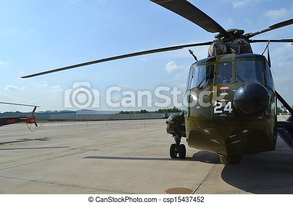 military helicopter on the ground - csp15437452