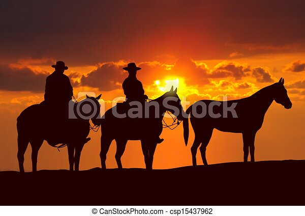 cowboys and horses under sunset - csp15437962